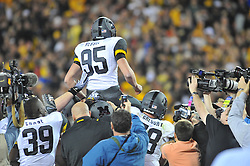 Nov 28, 2009; Kansas City, MO, USA; Grant Ressel (95) is hoisted and congratulated after kicking the winning field goal in the game against the Kansas Jayhawks at Arrowhead Stadium. The Tigers won 41-39. Mandatory Credit: Denny Medley-US PRESSWIRE