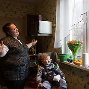 """CAPTION: Lev's mother Svetlana has become a hard-working activist for disabled people's rights. """"Action is the way out of this lonely existence"""", she explains. LOCATION: St Petersburg, Russia. INDIVIDUAL(S) PHOTOGRAPHED: Svetlana Guseva (mother) and Lev Gusev (son)."""