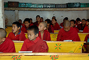 Attentive young monks in class at the state monastic school Dechen Phodrung Monastery.. Thimpu, Druk Yul, Bhutan. 13 November 2007