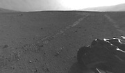 NASA's Curiosity rover drove about 52 feet eastward, the longest drive of the mission so far. The drive imprinted the wheel tracks visible in this image.