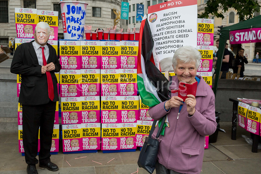 On US President Donald Trumps second day of a controversial three-day state visit to the UK, a Trump figure stands beside milkshakes, as protesters voice their opposition to the 45th American President, in Trafalgar Square, on 4th June 2019, in London England.
