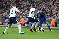 AFC Wimbledon striker Andy Barcham (17) battles for possession with Victor Wanyama of Tottenham Hotspur (12)  during the The FA Cup 3rd round match between Tottenham Hotspur and AFC Wimbledon at Wembley Stadium, London, England on 7 January 2018. Photo by Matthew Redman.