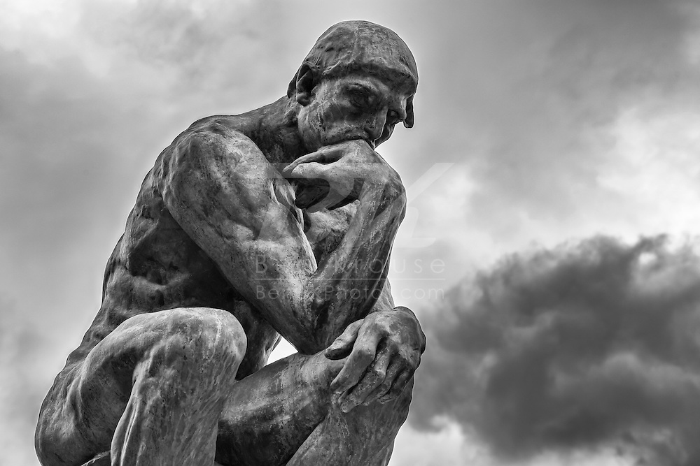 The Thinker by sculptor Auguste Rodin in Paris, France on May 19, 2012.  The Rodin Museum features many of his sculptures laid out in an outdoor garden.