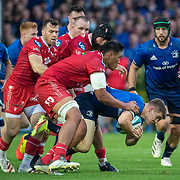 DUBLIN, IRELAND: October 16:  Garry Ringrose #13 of Leinster defended by Sam Lousi #4 of Scarlets, Blade Thomson #8 of Scarlets and Gareth Davies #9 of Scarlets during the Leinster V Scarlets, United Rugby Championship match at RDS Arena on October 16th, 2021 in Dublin, Ireland. (Photo by Tim Clayton/Corbis via Getty Images)