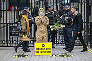 March 17, 2020, London, United Kingdom: Activists of ''Pause the System'' group hold a symbolic protest at Downing Street. The group is demanding the government to follow the World Health organisation's rules and get involved with enforcing isolation to prevent the spread of coronavirus across the country. (Credit Image: © Vedat Xhymshiti/ZUMA Wire)
