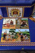 Ceramic tiles on street furniture seat scenes from Cervantes Don Quixote story, Algeciras, Spain