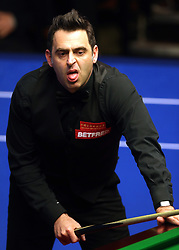 Ronnie O'Sullivan reacts after a missed shot against Ding Junhui, on day twelve of the Betfred Snooker World Championships at the Crucible Theatre, Sheffield.
