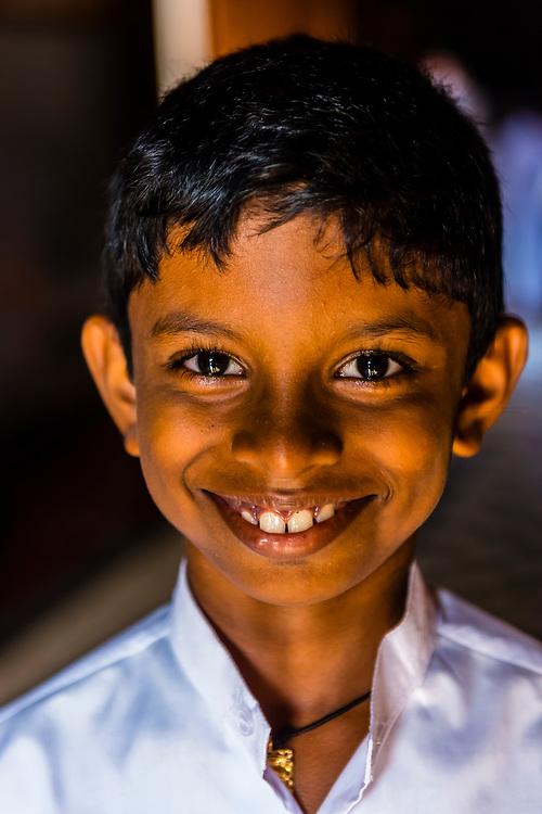 School boy, Isurumuniya Temple, Anuadhapura. SrI Lanka. Anuradhapura is one of the ancient capitals of Sri Lanka, famous for its well-preserved ruins of an ancient Sri Lankan civilization.
