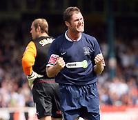 Photo: Chris Ratcliffe.<br />Southend United v Stoke City. Coca Cola Championship.<br />05/08/2006.<br />Lee Bradbury of Southend celebrates winninjg a penalty after Steve Simonsen (background) brought him down.