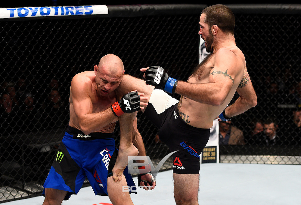 TORONTO, CANADA - DECEMBER 10:  (R-L) Matt Brown knees Donald Cerrone in their welterweight bout during the UFC 206 event inside the Air Canada Centre on December 10, 2016 in Toronto, Ontario, Canada. (Photo by Jeff Bottari/Zuffa LLC/Zuffa LLC via Getty Images)