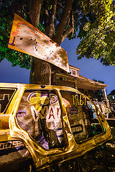 View on Heidelberg Street. including Obstruction of Justice House, Heidelberg Project, Detroit, Michigan.  The Heidelberg Project is a grass roots project started by artist Tyree Guyton that uses art to help revitalize the embattled neighborhood.  Each year, over 275,000 people visit the project .  For more information, go to www.heidelberg.org