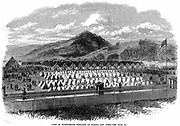 American Civil War 1861-1865: Confederate (southern) prisoners in Federal (northern) prison camp at Elmira, New York Stare. About 10,000 men held in huts and under canvas in enclosure of about 20 acres .From 'The Illustrated London News', March 1865. Wood engraving.