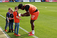 Luton Town midfielder Mpanzu Pelly-Ruddock (17) signing autographs before the EFL Sky Bet League 1 match between Luton Town and Bristol Rovers at Kenilworth Road, Luton, England on 15 September 2018.