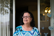 Antoinette Doyle poses for a portrait at her home in the Sunnyhills Apartments in Milpitas, California, on May 26, 2017. Doyle has lived at the apartment complex for 22 years, 7 of which in a low income subsidized studio, and is now facing eviction due to the owner's desire for luxury apartments. (Stan Olszewski/SOSKIphoto)