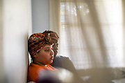 MONTGOMERY, AL – JUNE 11, 2019: Myra Powell is seen in the apartment she rents with her fiancé, Stefvenie Buckner, in the Capitol Heights neighborhood. At age 19, while 26 weeks pregnant, Powell suffered a catastrophic placental abruption and was taken by ambulance to a nearby hospital. While there, doctors discovered her placenta had fully detached from the uterine wall, depriving her twin boys of oxygen. Silas and Stefvon died in utero. Narrowly escaping death herself, Powell would later be diagnosed with HELLP syndrome, a pregnancy-induced blood pressure condition in the eclampsia family that kills nearly a third of all women who develop it. As a young, poor, black woman from the south, Powell represents the deadliest cross-section of demographics among mothers in America, where more women die from pregnancy related causes than any other wealthy country in the world.
