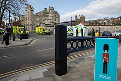 Windsor, UK. 16th April, 2021. Thames Valley Police officers and emergency ambulances are positioned outside Windsor Castle on the eve of the funeral of the Duke of Edinburgh. The funeral of Prince Philip, Queen Elizabeth II's husband, will take place at St George's Chapel in Windsor Castle at 15:00 BST on 17th April.
