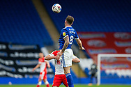 Cardiff City's Joe Ralls (8) heads clear during the EFL Sky Bet Championship match between Cardiff City and Millwall at the Cardiff City Stadium, Cardiff, Wales on 30 January 2021.