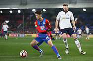 Lee Chung-Yong of Crystal Palace takes the ball past Mark Beevers of Bolton Wanderers . Emirates FA Cup 3rd round replay match, Crystal Palace v Bolton Wanderers at Selhurst Park in London on Tuesday 17th January 2017.<br /> pic by John Patrick Fletcher, Andrew Orchard sports photography.