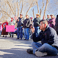 112614       Cable Hoover<br /> <br /> Dusty Lee uses his phone to take video of speakers and other supports during a Navajo Voter's Rights Coalition protest at the Navajo Council Chambers in Window Rock Wednesday.