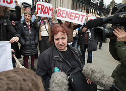 © Licensed to London News Pictures. 23/03/2016. London, UK. Disabled protestor Claire Glasman talks to reporters after being ejected from Parliament where she was demonstrating against government cuts to benefits.  Photo credit: Peter Macdiarmid/LNP