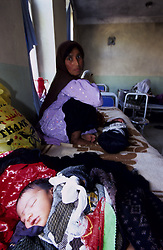FAIZABAD PROVINCIAL HOSPITALl, 27 July 2005..A mother sits herself down with her newborn baby.....According to United Nations Population Fund, Afghanistan has among the world?s highest rates of maternal mortality, and Badakhshan has the highest rates ever recorded anywhere in the world, with one mother dying in every 15 births.