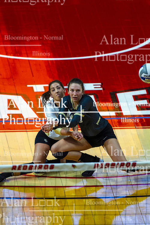 BLOOMINGTON, IL - September 14: Makenzie Kuchmaner and Kristina Fisher collide for a dig during a college Women's volleyball match between the ISU Redbirds and the University of Central Florida (UCF) Knights on September 14 2019 at Illinois State University in Normal, IL. (Photo by Alan Look)