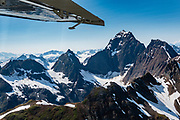 """Flightseeing from Skagway or Haines is a spectacular way to see Glacier Bay National Park, in Alaska, USA. We were bedazzled by Mountain Flying Service's 1.3-hour West Arm tour from Skagway. Glacier Bay is honored by UNESCO as part of a huge Biosphere Reserve and World Heritage site shared between Canada and the United States. In 1750-80, Glacier Bay was totally covered by ice, which has since radically melted away. In 1794, Captain George Vancover found Icy Strait on the Gulf of Alaska choked with ice, and all but a 3-mile indentation of Glacier Bay was filled by a huge tongue of the Grand Pacific Glacier, 4000 feet deep and 20 miles wide. By 1879, naturalist John Muir reported that the ice had retreated 48 miles up the bay. In 1890, """"Glacier Bay"""" was named by Captain Beardslee of the U.S. Navy. Over the last 200 years, melting glaciers have exposed 65 miles of ocean. As of 2019, glaciers cover only 27% of the Park area. Since the mid 1900s, Alaska has warmed 3 degrees Fahrenheit and its winters have warmed nearly 6 degrees. Human-caused climate change induced by emissions of greenhouse gases continues to accelerate warming at an unprecedented rate. Climate change is having disproportionate effects in the Arctic, which is heating up twice as fast as the rest of Earth."""