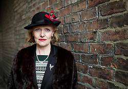 © Licensed to London News Pictures. <br /> 15/10/2016. <br /> Pickering, UK.  <br /> <br /> A woman dressed in period clothing stands for a photograph in Pickering during the North Yorkshire Moors Railway Wartime Weekend event. <br /> The annual event brings together re-enactors and enthusiasts along the length of the NYMR heritage steam railway line to recreate the feel of the war years of the 1940's. <br /> <br /> Photo credit: Ian Forsyth/LNP
