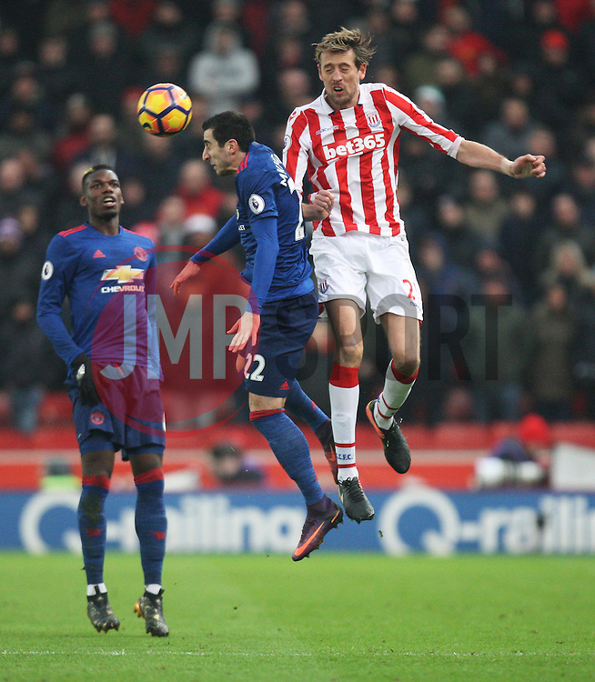 Henrikh Mkhitaryan of Manchester United and Peter Crouch of Stoke City in action - Mandatory by-line: Jack Phillips/JMP - 21/01/2017 - FOOTBALL - Bet365 Stadium - Stoke-on-Trent, England - Stoke City v Manchester United - Premier League