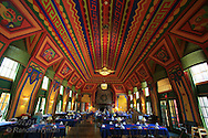 Ornate 30 x 80-foot dining room is covered with Cree Indian designs painted by French artist Antoine Goufee across its 20'-high domed ceiling at Naniboujou Lodge, Minnesota.