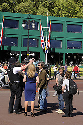 ©  licensed to London News Pictures. . UK.27/04/2011.Royal Wedding Preparations today in London with only two days to go before the big day..Police Officer moving on a foreign film crew today, telling to get back to the press area..Please see special instructions..Picture credit should read Grant Falvey/LNP......