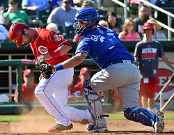March 7, 2017 - Goodyear, AZ, USA - Kansas City Royals catcher Cam Gallagher tags out the Cincinnati Reds' Jesse Winker, left, at the plate during spring training at Goodyear Ballpark in Goodyear, Ariz., on Tuesday, March 7, 2017. The Reds won, 7-3. (Credit Image: © John Sleezer/TNS via ZUMA Wire)