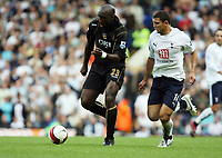Photo: Chris Ratcliffe.<br /> Tottenham Hotspur v Portsmouth. The Barclays Premiership. 01/10/2006.<br /> Sol Campbell (L) of Portsmouth clashes with Hossam Ghaly of Spurs.
