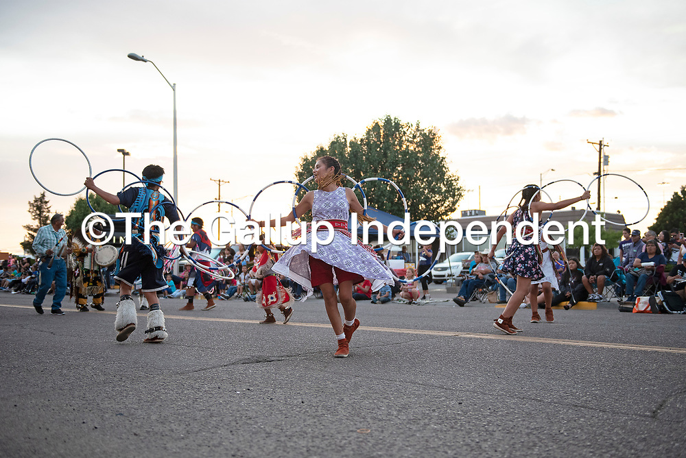 Native Sky Hoop Dancers from Pinedale, New Mexico perform during the annual Gallup Inter-Tribal Indian Ceremonial night parade Thursday evening on Coal Avenue in Gallup.