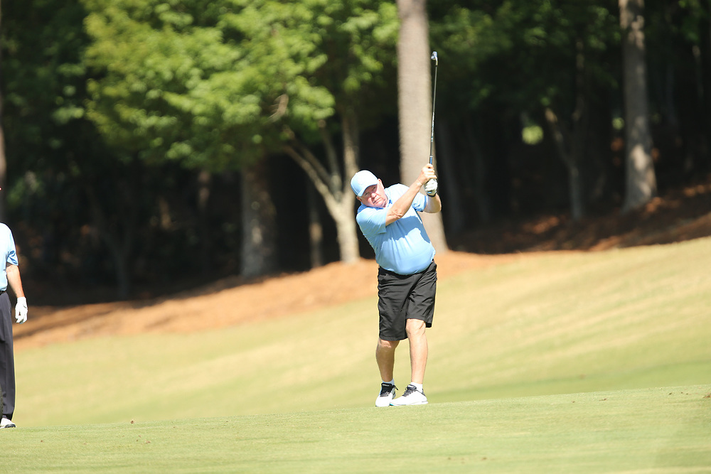North Carolina head football coach Mack Brown tees off during the Chick-fil-A Peach Bowl Challenge at the Ritz Carlton Reynolds, Lake Oconee, on Tuesday, April 30, 2019, in Greensboro, GA. (Chris Collins via Abell Images for Chick-fil-A Peach Bowl Challenge)
