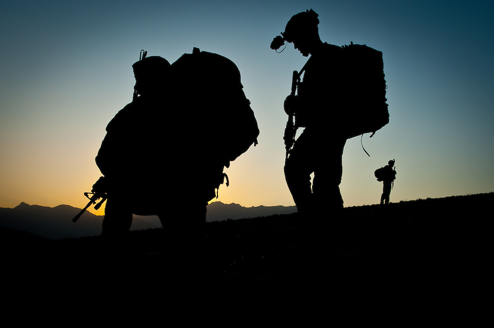 Wardak, Afghanistan: Images from a patrol in the Nerkh Valley with Blackhawk Company of the 2-87 Infantry Regiment, 3rd Brigade, 10th Mountain Division. Soldiers silhouetted by the sunset during an overnight patrol.