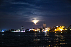 November 14, 2016 - Gaza, Palestine - November 14, 2016 shows the moon on the eve of the ''supermoon'' spectacle ,People watching the moon rises over From the port of Gaza in Monday, Nov. 14, 2016. The brightest moon in almost 69 years lit up the sky, during its closest approach to earth as the ''Supermoon'' reached its most luminescent phase. The moon won't be this close again until Nov. 25, 2035. (Credit Image: © Ezz Al-Zanoun/NurPhoto via ZUMA Press)