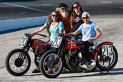 Gloria Struck on Steve Coe's flathead racer with daughter Lori DiSilva (on another one of Steve's bikes), grand-daughter Cathy and Steve Coe on the New Smyrna Speedway after the Sons of Speed Race during Daytona Bike Week. New Smyrna Beach, FL. USA. Saturday March 17, 2018. Photography ©2018 Michael Lichter.