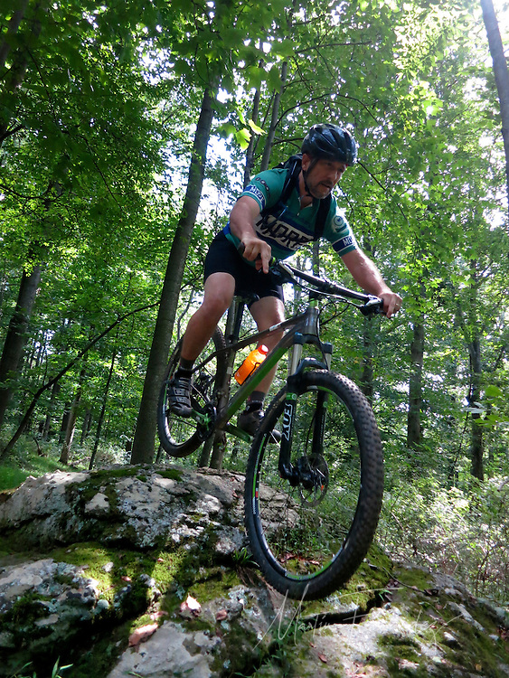 Austin Steo, lead builder of the Emmitsburg Rainbow trails, enjoys the fruits of his labor.