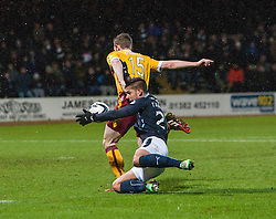 Dundee's Luka Tankulic and Motherwell's Mark O'Brien  clash on way the the ball ends up in the net for Dundee's fourth goal. <br /> Dundee 4 v 1 Motherwell, SPFL Premiership played 10/1/2015 at Dundee's home ground Dens Park.