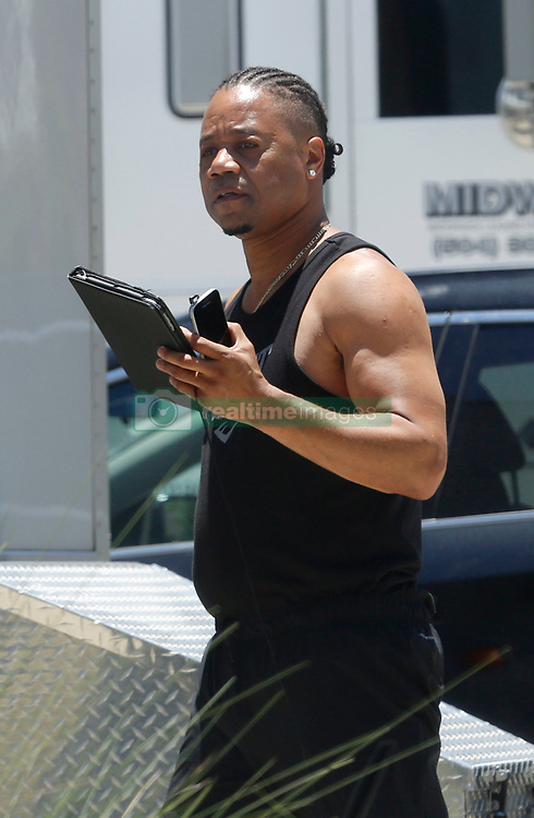 EXCLUSIVE: ***FIRST ONSET PHOTOS*** New Look for Cuba Gooding Jr. as he's seen with long tied back braids and a chin beard as he starts production on Louisiana Caviar, an independently financed New Orleans-set thriller in which he stars and that marks the directing debut. Gooding Jr. was spotted filming scenes Famke Janssen at Avenue Pub in New Orleans. Famke was adorned with tattoos while wearing cut off daisy duke shorts and Vans sneakers. Gooding Jr. could be seen with 'Nike' hooded jacket and sneakers as well as an 'Everlast' tshirt. The film is a tale of sin involving good people who, out of desperation, resort to doing bad things that inevitably leave them with life-changing consequences. Gooding Jr plays a boxer in the twilight of his career. Gooding Jr. recently played OJ Simpson in Ryan Murphy's American Crime Story and followed with an American Horror Story arc,. 19 Jun 2017 Pictured: Cuba Gooding Jr. Photo credit: MEGA TheMegaAgency.com +1 888 505 6342