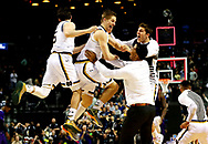 NEW YORK, NY - MARCH 20:  Rex Pflueger #0 of the Notre Dame Fighting Irish and teammates celebrate their 76 to 75 win over the Stephen F. Austin Lumberjacks during the second round of the 2016 NCAA Men's Basketball Tournament at Barclays Center on March 20, 2016 in the Brooklyn borough of New York City.  (Photo by Elsa/Getty Images)
