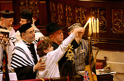 BRUSSELS, BELGIUM - JAN-30-2005 -  Concentration camp survivors and their families light candles during a memorial service at the Grand Synagogue in Brussels in remembrance of the liberation of the notorious Nazi concentration camp at Auschwitz. (REPORTERS © JOCK FISTICK)