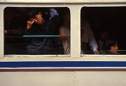 Commuters crowd onto a bus in Shanghai, China.