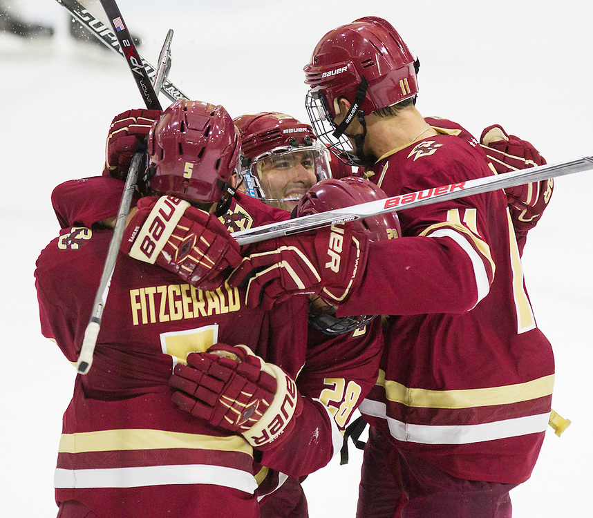 Boston College Forward Miles Wood (28) celebrates with Defenseman Casey Fitzgerald (5), and Forward Chris Calnan (11) after Fitzgerald scored a goal during the second period of a NCAA hockey game between Army and Boston College at Tate Rink on October 9, 2015 in West Point, New York. (Dustin Satloff)