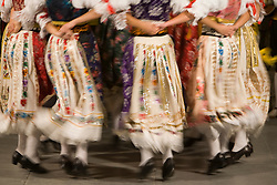 Europe, Croatia, Dalmatia, Dubrovnik.  Folk dancers in traditional costumes (blurred motion)