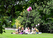 © Licensed to London News Pictures. 21/07/2012. London, UK. A group of girls picnic. People enjoy the warm weather in Battersea Park today 21st July 2012. Photo credit : Stephen Simpson/LNP