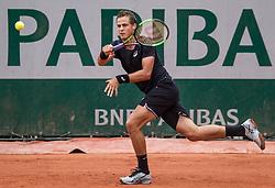 May 29, 2018 - Paris, France - Vasek Pospisil of Canada returns the ball to Márton Fucsovics of Hungary during the first round at Roland Garros Grand Slam Tournament - Day 3 on May 29, 2018 in Paris, France. (Credit Image: © Robert Szaniszlo/NurPhoto via ZUMA Press)