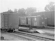 Box car #3575 in yard at Salida with standard gauge wooden box cars.<br /> D&RGW  Salida, CO  Taken by Axt, Vernon