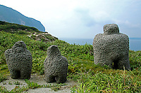"""Niijima Moai Though they are called """"moai"""" these artifacts are more like outdoor sculptures, dotted along the coastline of Niijima. Oddly enough, Niijima Island is a part of Tokyo although it in no way resembles the crowded city or any city for that matter.  In fact, it is more of a tropical paradise and hangout for surfer dudes, with huge wages and surf.  To make life more interesting, or some other reason, Niijima also has a smattering of moai or public art sculptures along the coast.  Though they are called """"moai"""" these artifacts are more sculptures, dotted along the coastlines of Niijima.  Most of them are made of ryolite, a precious volcanic rock that is mined only on Niijima.  These sculptures are actually called moyai by the locals which means 'work together' in their dialect."""